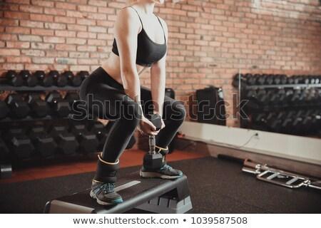 Közelkép lány lépés kardio súlyzók tornaterem Stock fotó © Yatsenko