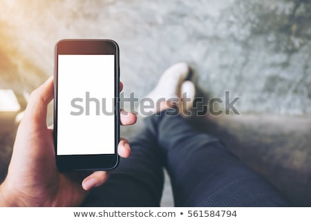 Male hand holding mobile phone with blank mock up screen Stock photo © stevanovicigor