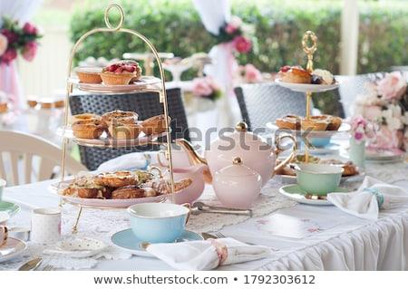 Magas tea szett desszert délutáni tea étterem Stock fotó © Yatsenko