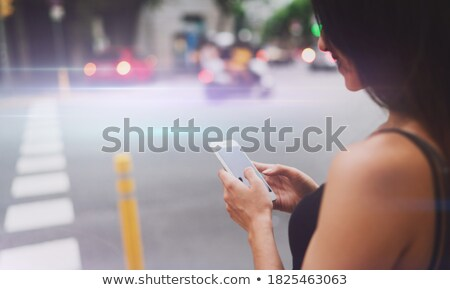 back view image of young woman designer chatting by phone stock photo © deandrobot