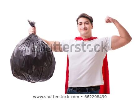 the superhero man with garbage sack isolated on white stock photo © elnur