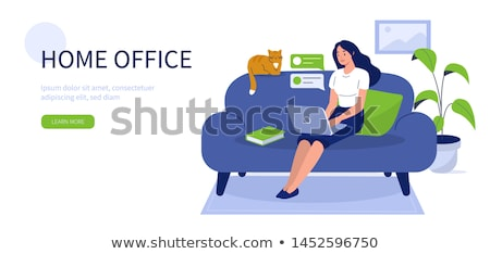 Woman sitting in computer room with people in background stock photo © monkey_business