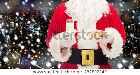 the man in costume of santa claus over night city background stock photo © master1305