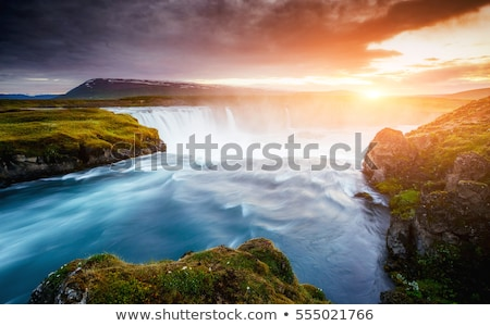 the rapid flow of water powerful godafoss cascade location plac stock photo © leonidtit