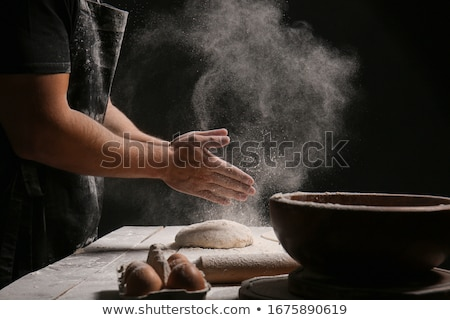 Flour sprinkled over dough Stock photo © wavebreak_media