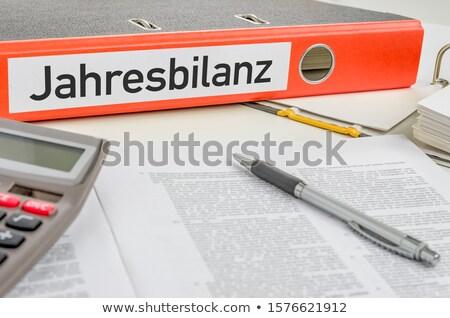 an orange folder with the label annual balance stock photo © zerbor