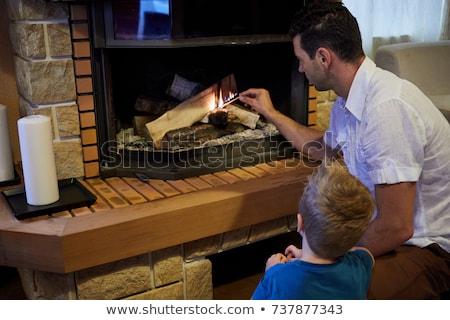 Man kindles a fireplace Stock photo © Anna_Om