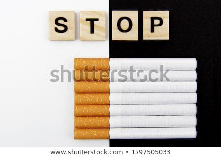 Cigaretta fakockák mutat stop szó közelkép Stock fotó © AndreyPopov