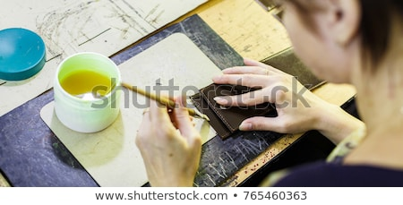 woman smearing with glue a part of a wallet Stock photo © Traimak