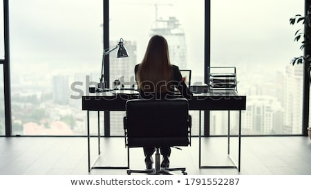Businesswoman looking out window Stock photo © IS2