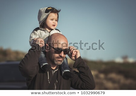 man carrying baby in park stock photo © is2