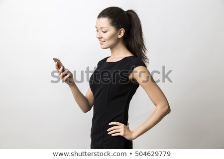 side view of attractive relaxed businesswoman standing stock photo © feedough