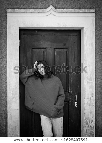 black and white photo of a beautiful woman in a doorway Stock photo © dmitriisimakov