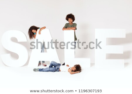 Happy three afro children with sale letters. Stock photo © NeonShot