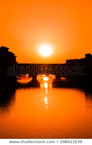 Arno river waterfront of Florence sunset view Stock photo © xbrchx