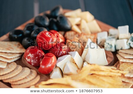 Delicious mix of different snacks and appetizers Stock photo © dash