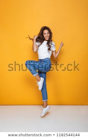 retrato · menina · feliz · longo · cabelo · escuro · saltando - foto stock © deandrobot