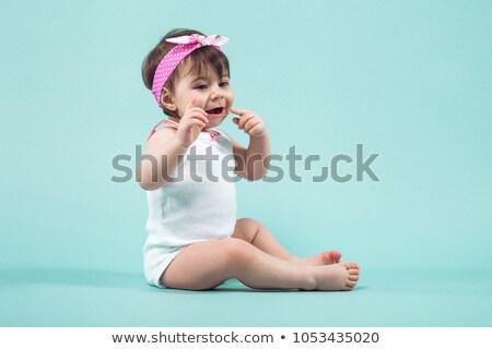 Aranyos kicsi mosolyog lány rózsaszín íj Stock fotó © Traimak