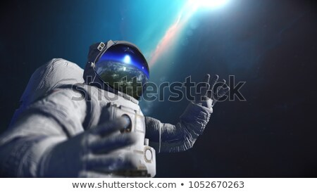 Astronaut in outer space against the backdrop of the planet eart Stock photo © cookelma