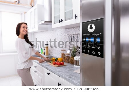 An Oven With Voice Recognition Function Near Woman Cutting Vegetables Stock photo © AndreyPopov