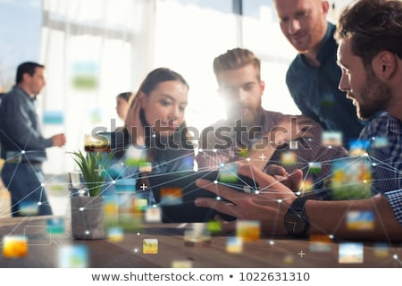 Businesswoman works in office with a tablet. Concept of internet sharing and company startup Stock photo © alphaspirit