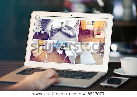 Nő ellenőrzés otthon biztonság fényképezőgépek laptop Stock fotó © AndreyPopov