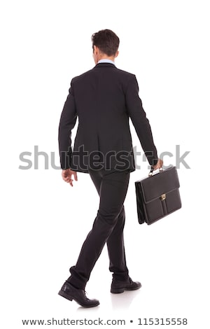 side of a walking man holding briefcase and looking back stock photo © feedough