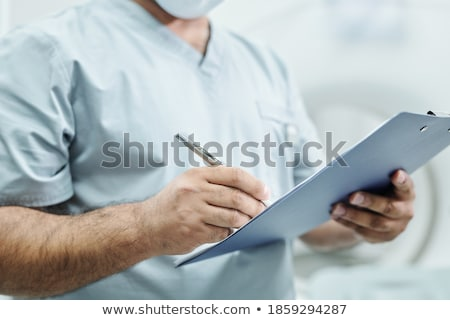 man with tablet clipboard in hand of male worker stock photo © robuart