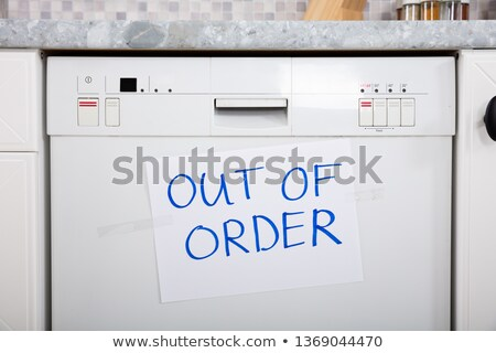 Out Of Order Text Stuck On Dishwasher Stock photo © AndreyPopov