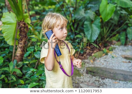 Boy listens to a radio guide, tourism concept stock photo © galitskaya