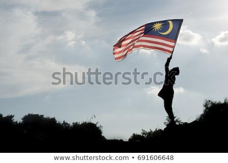 Boy travels in malaysia with malaysia flag celebrating the Malay Stock photo © galitskaya