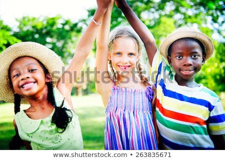 Feliz ninos las manos en alto verano parque Foto stock © dolgachov