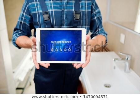 技術者 タッチパッド 表示 ストックフォト © pressmaster