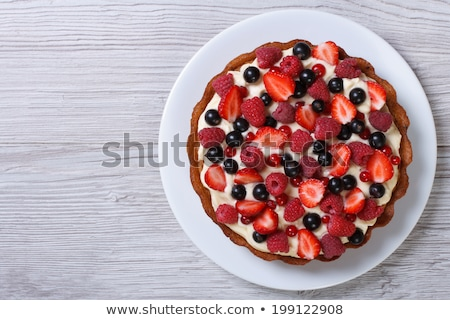 delicious tart with fresh strawberries on the table top view horizontal stock photo © x-etra
