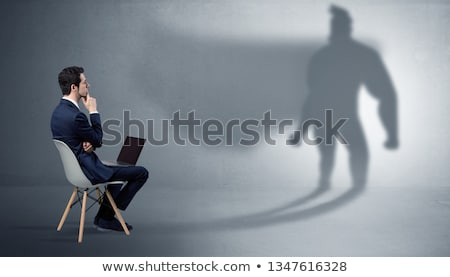 Businessman staying and offering stuffs to a superhero shadow Stock photo © ra2studio