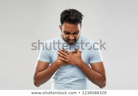 unhappy indian man suffering from heartache Stock photo © dolgachov