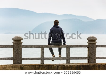 young man relaxing on the seashore Stock photo © nito