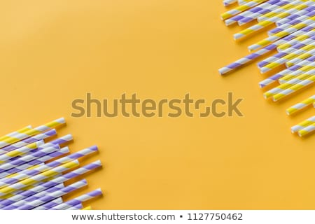 An orange soft drink with a straw Stock photo © Zerbor