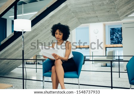 Confident economist analyzing financial information on blackboard in office Stock photo © pressmaster