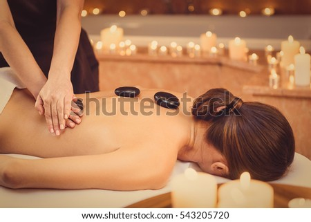 therapy with hot stones in spa center Stock photo © olira