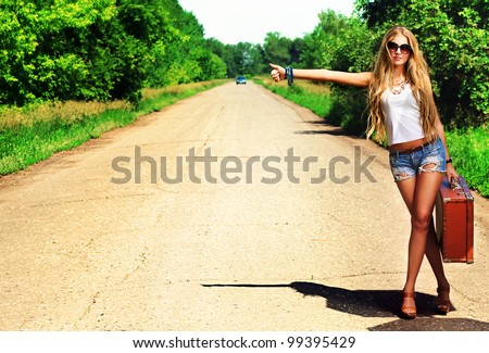 Female hitchhiker on country road Stock photo © sumners