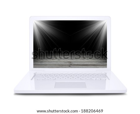 On the laptop screen shows a wooden floor floodlit Stock photo © cherezoff