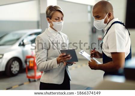 businesswoman taking digital tablet in car stock photo © kzenon