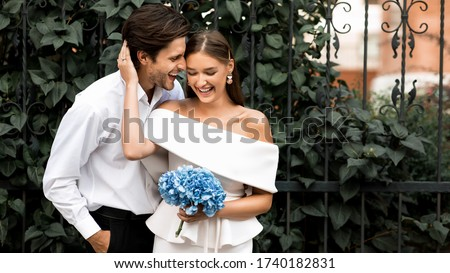 Bride and groom have fun during the day stock photo © ruslanshramko