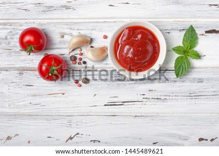 Tomato ketchup sauce on wooden background Stock photo © furmanphoto