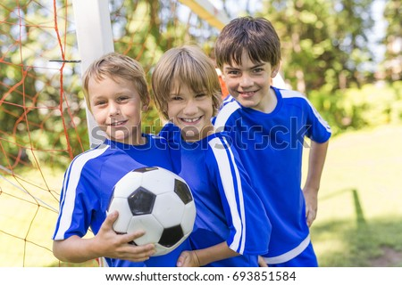 three, Young boy with soccer ball on a sport uniform Stock photo © Lopolo