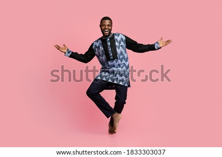 Image of happy african american guy smiling and gesturing as win Stock photo © deandrobot