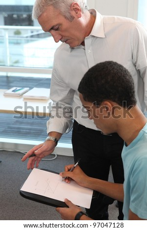 Teacher supervising his student's work Stock photo © photography33