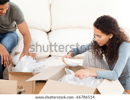 Woman packing glasses/plates in boxes Stock photo © IS2