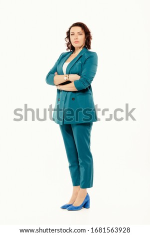 portrait of confident casual woman standing with crossed arms stock photo © feedough